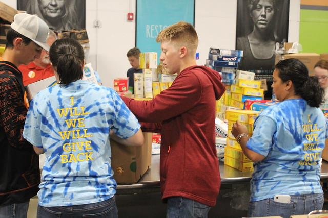 FFA students pack food for food bank